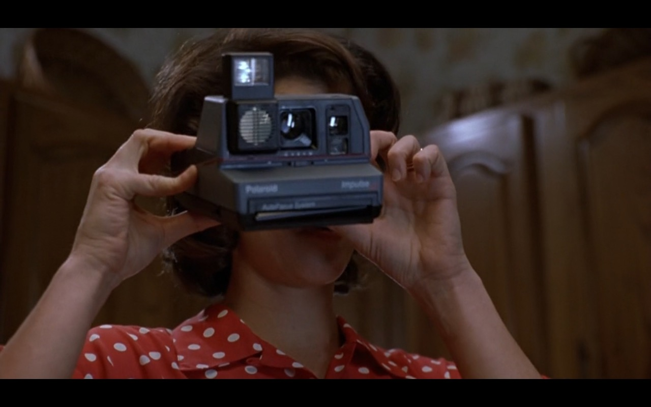 Polaroid - Romeo Is Bleeding (1993) Movie Product Placement