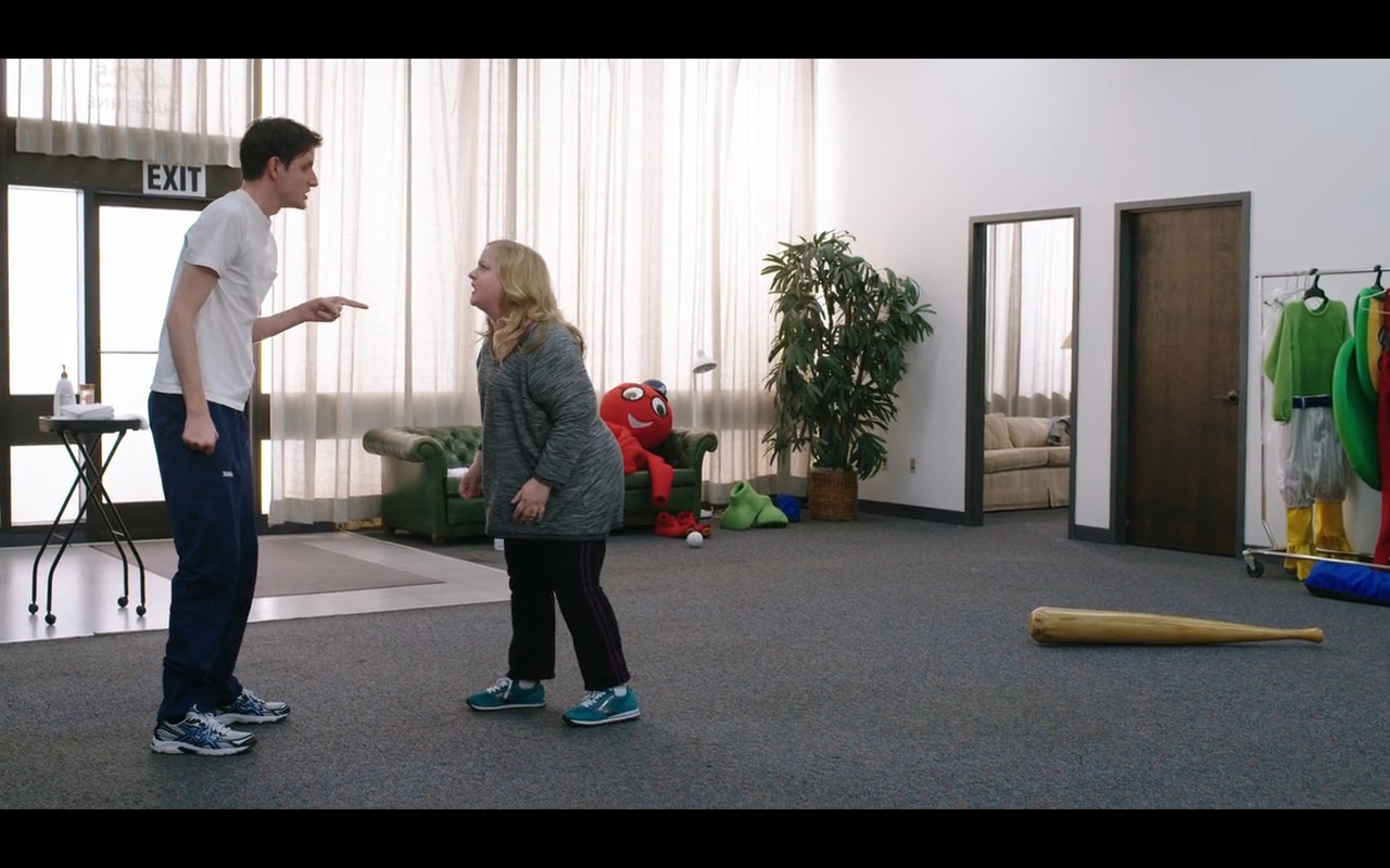Asics Men's Sneakers And Nike Women's Sneakers – Mascots (2016) Movie Product Placement