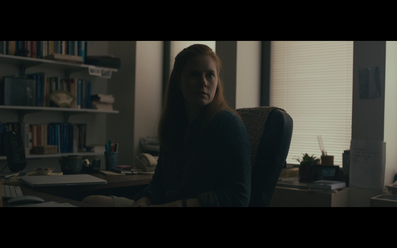 Apple MacBook And Logitech Speakers - Arrival (2016) Movie Product Placement