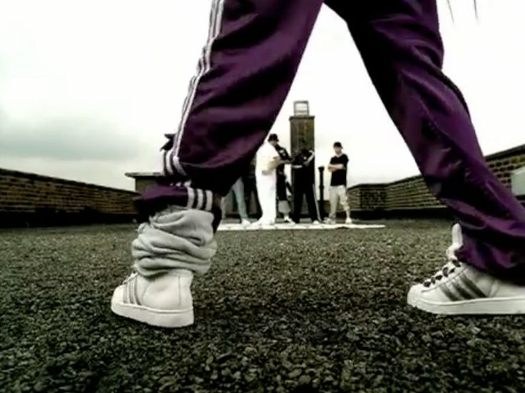 Adidas track pants and shoes in LOVE OF MY LIFE by Erykah Badu (2002) Official Music Video