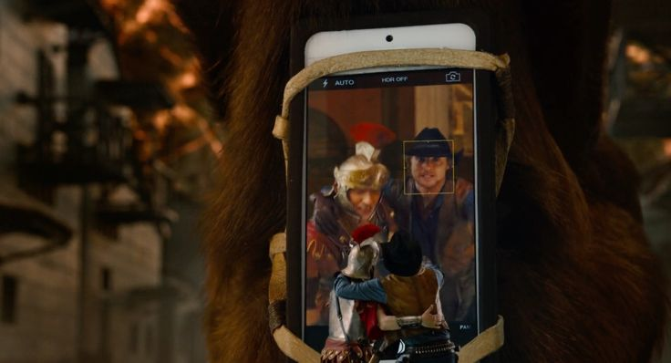 Apple iPhone mobile phone in NIGHT AT THE MUSEUM: SECRET OF THE TOMB (2014) Movie Product Placement