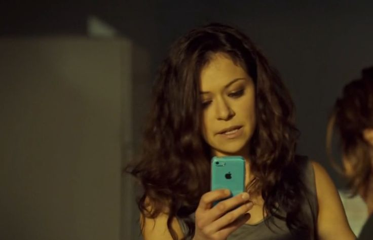 Apple iPhone mobile phone used by Tatiana Maslany in ORPHAN BLACK: TRANSITORY SACRIFICES OF CRISIS (2015) - TV Show Product Placement