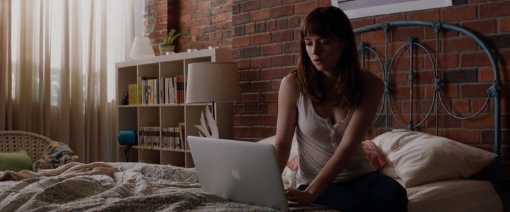 Apple laptop used by Dakota Johnson in FIFTY SHADES OF GREY (2015) Movie Product Placement