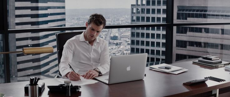 Apple laptop used by Jamie Dornan in FIFTY SHADES OF GREY (2015) Movie Product Placement