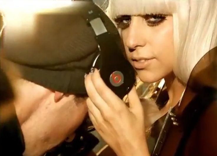 Beats by Dre headphones held by Lady Gaga in POKER FACE (2008) Official Music Video Product Placement