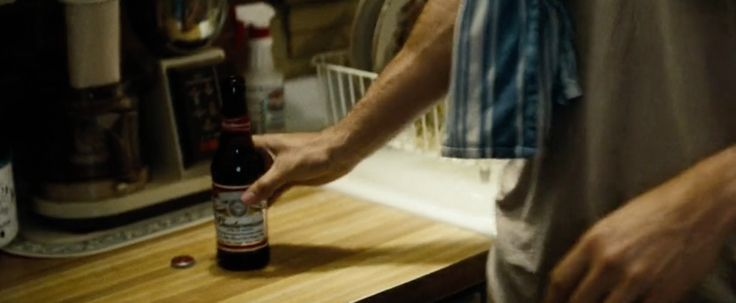 Budweiser beer drunk by Henry Cavill in MAN OF STEEL (2013) Movie Product Placement