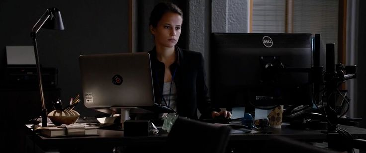Dell laptop and monitor used by Alicia Vikander in JASON BOURNE (2016) Movie Product Placement