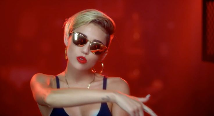 Gianfranco Ferre Gold Mirror sunglasses worn by Miley Cyrus in 23 by Mike WiLL Made It (2013) - Official Music Video Product Placement