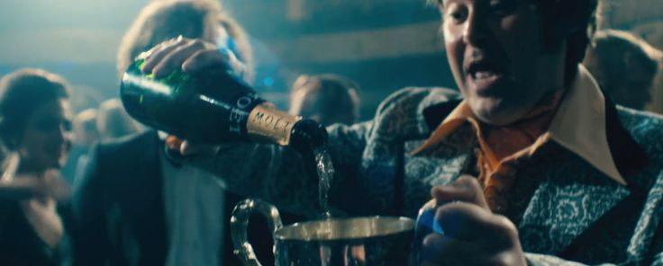 Moët & Chandon champagne poured by Christian McKay in RUSH (2013) Movie Product Placement