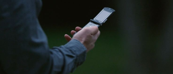 Motorola Razr mobile phone in THE EXPENDABLES 3 (2014) Movie Product Placement