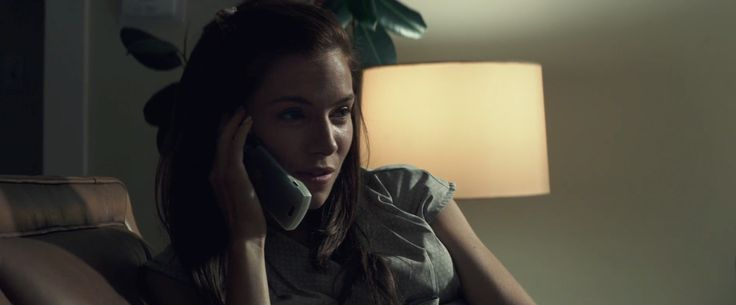 Motorola Razr mobile phone used by Sienna Miller in AMERICAN SNIPER (2014) Movie Product Placement
