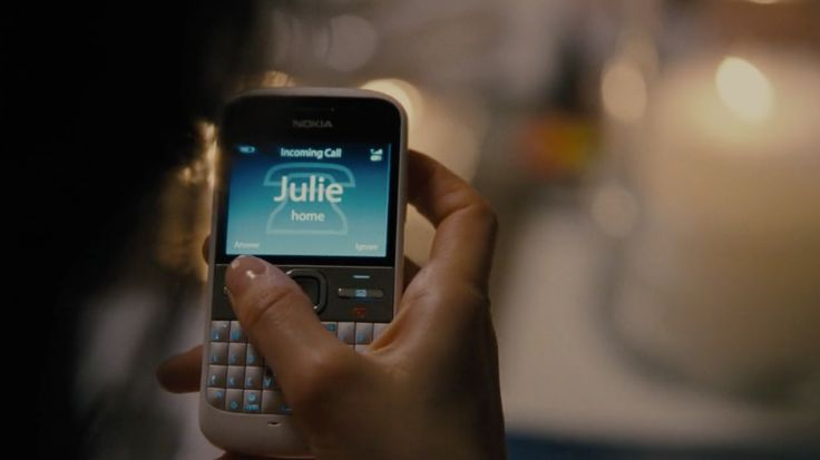 Nokia E5 mobile phone used by Laetitia Casta in ARBITRAGE (2012) Movie Product Placement