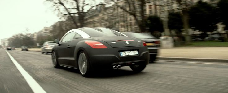 Peugeot RCZ driven by Amber Heard in 3 DAYS TO KILL (2014) Movie Product Placement
