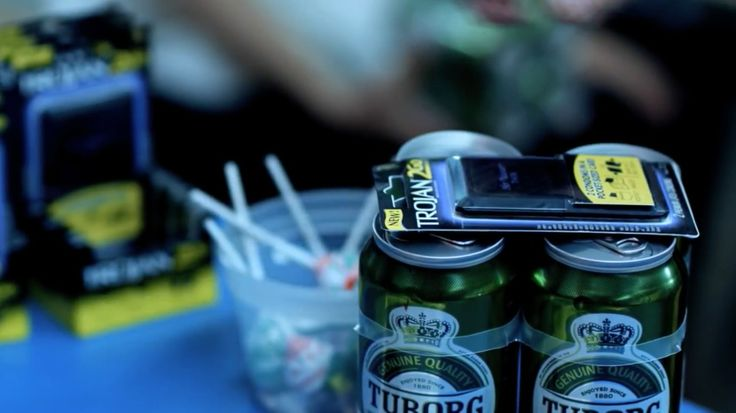 Tuborg beer and Trojan condoms in GOOD GIRLS GO BAD by Cobra Starship (2009) - Official Music Video Product Placement