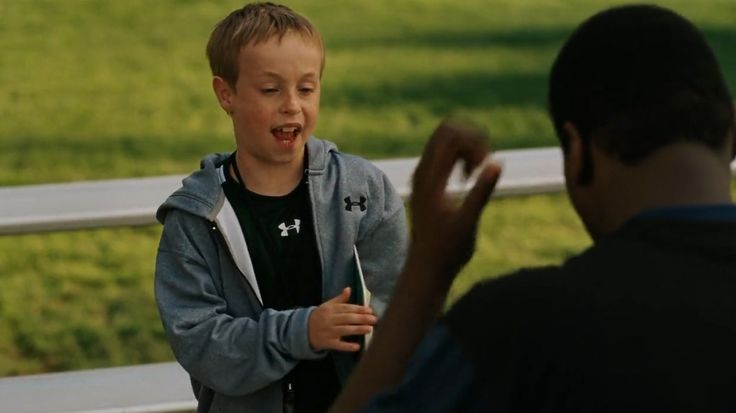 Under Armour t-shirt and jacket worn by Jae Head in THE BLIND SIDE (2009) Movie Product Placement