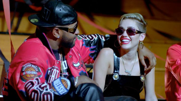 Versace Mod T75 Col 852 sunglasses and Chicago Bulls jacket worn by Mike WiLL Made It; Versace S64 sunglasses and vinyl dress worn by Miley Cyrus in 23 by Mike WiLL Made It (2013) - Official Music Video Product Placement