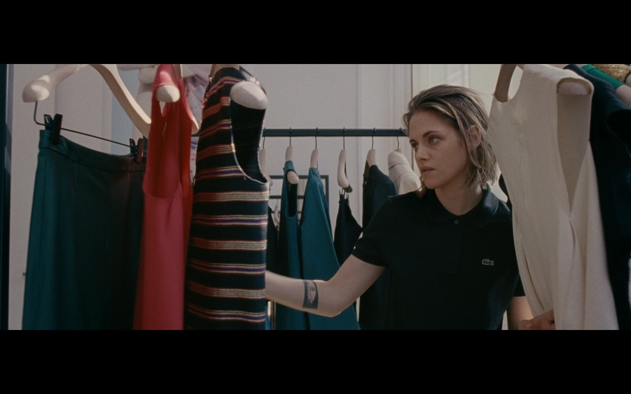 Kristen Stewart And Lacoste Black Polo Shirt – Personal Shopper (2016) Movie Product Placement