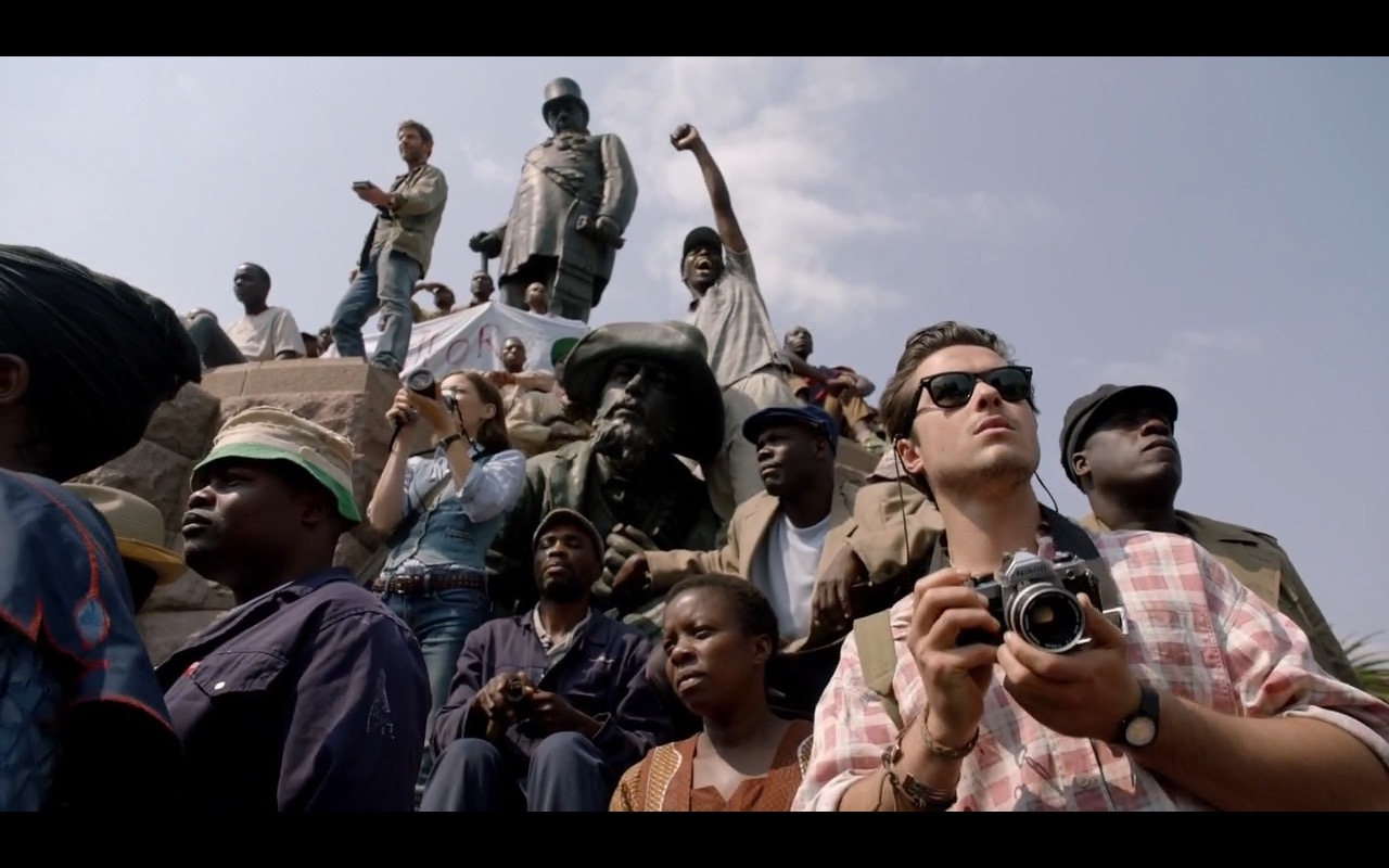 Ray-Ban Sunglasses And Nikon Camera - The Journey Is the Destination (2016) Movie Product Placement