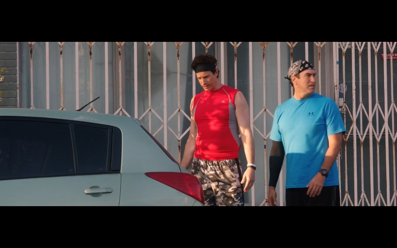 Champion Red Tee & Under Armour Blue T-Shirt - How to Be a Latin Lover (2017) Movie Product Placement