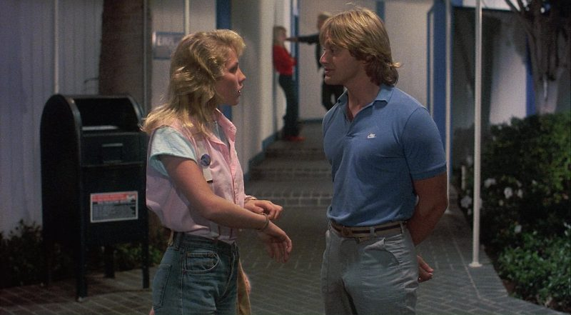 Nike Men's Blue Polo Shirt – Private Resort (1985) - Movie Product Placement