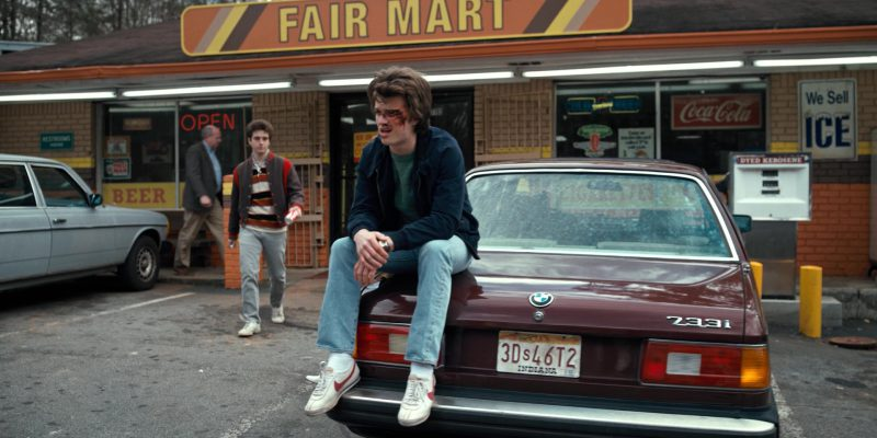 Coca-Cola Signs and Nike Shoes Worn by Joe Keery (Steve Harrington) in Stranger Things: The Bathtub (2016) TV Show Product Placement