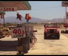 Tecate Beer and Coca-Cola Signs and Jeep CJ-7 SUV Used by Li...