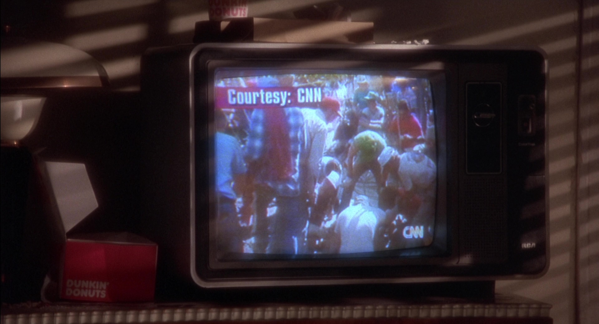 CNN, RCA TV and Dunkin' Donuts in Twelve Monkeys (1995) Movie