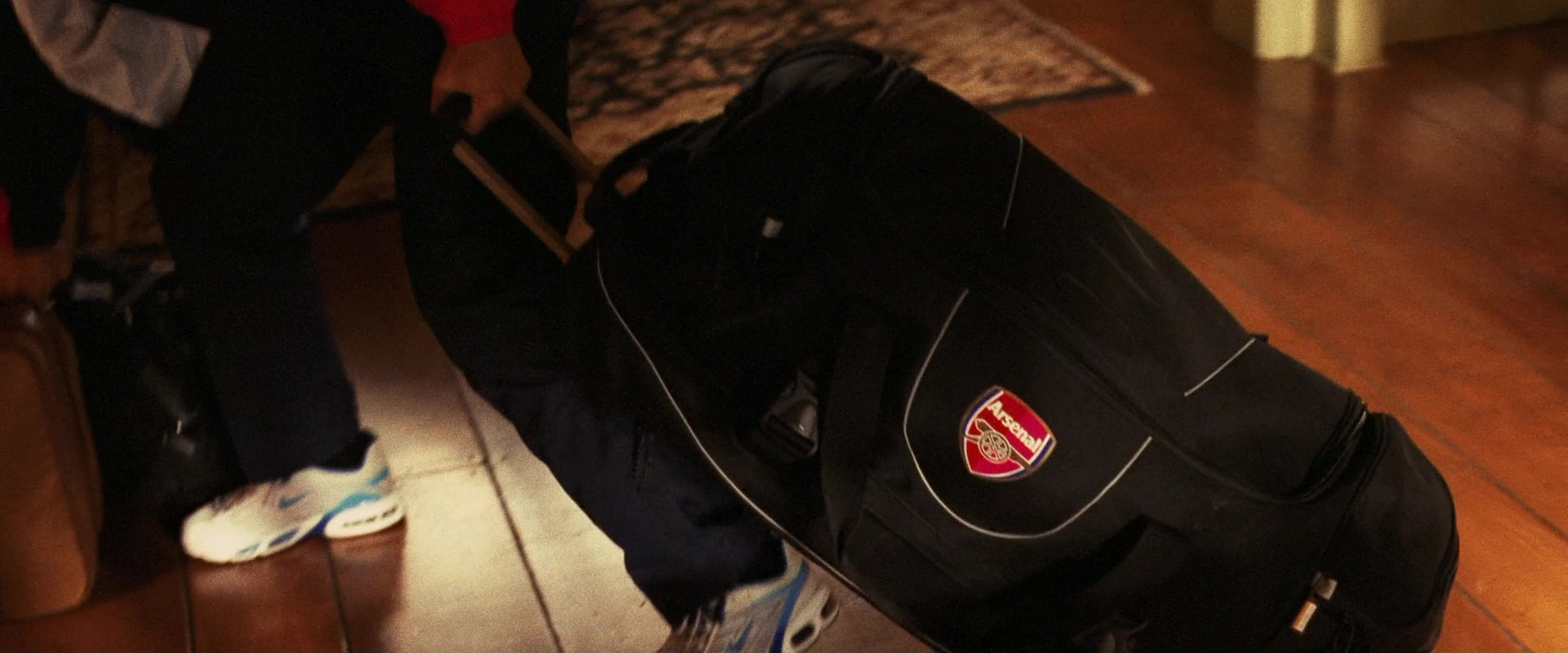 Nike and Arsenal F.C. Tracksuits and Nike Shoes in Ocean's Twelve (2004)  Movie Product