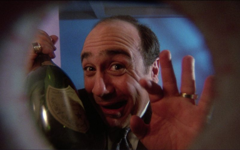 Dom Pérignon and Danny DeVito in Ruthless People (1)