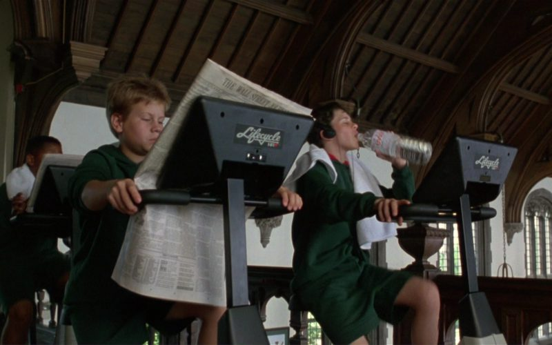 Lifecycle Stationary Exercise Bike by Life Fitness and Evian Water in Richie Rich (1)