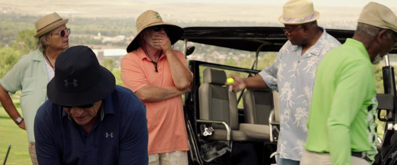 Under Armour Blue Polo Shirt And Black Golf Bucket Hat Worn by Tommy Lee Jones in Just Getting Started (2017) - Movie Product Placement