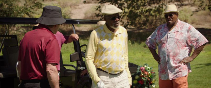 Under Armour Bucket Hat And Polo Shirt Worn by Tommy Lee Jones in Just Getting Started (2017) Movie Product Placement