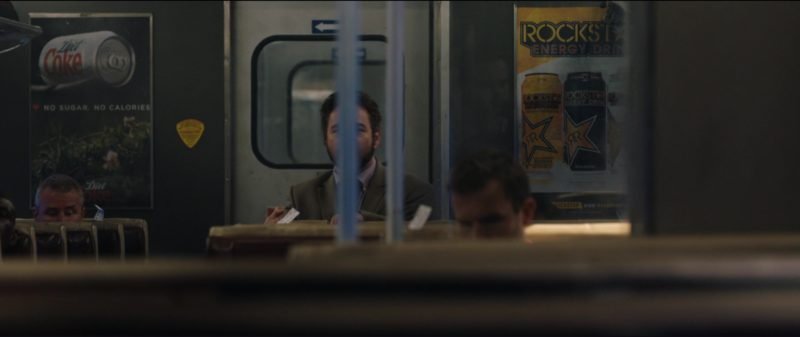 Diet Coke and Rockstar Energy Drink Posters in The Commuter (2018) Movie Product Placement