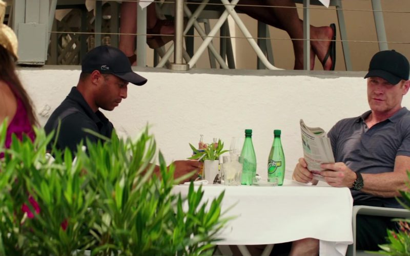 Lacoste Cap and Perrier Water in Fifty Shades Freed