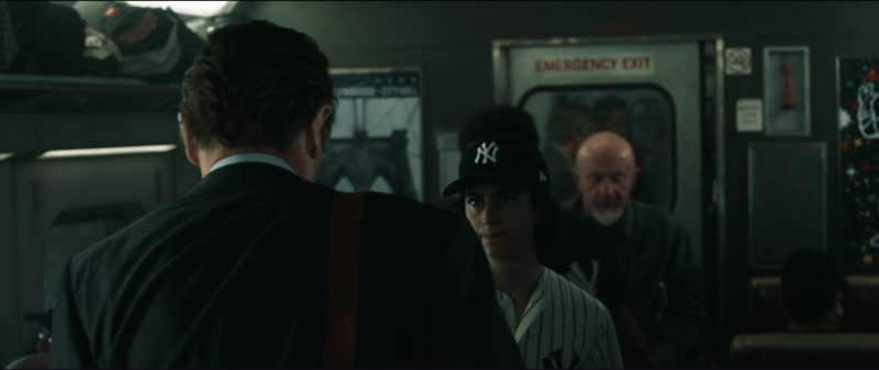 New York Yankees Caps and Outfits in The Commuter (2018) Movie Product Placement