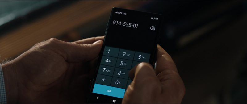 Windows Smartphone Used by Sam Neill in The Commuter (2018) Movie Product Placement