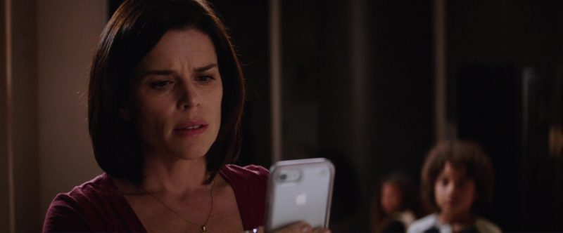 Apple iPhone Used by Neve Campbell in Skyscraper (2018) - Movie Product Placement