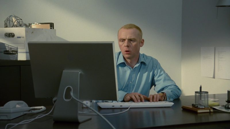 Bankers Boxes and Apple Monitor Used by Simon Pegg in How to Lose Friends & Alienate People (2008) - Movie Product Placement