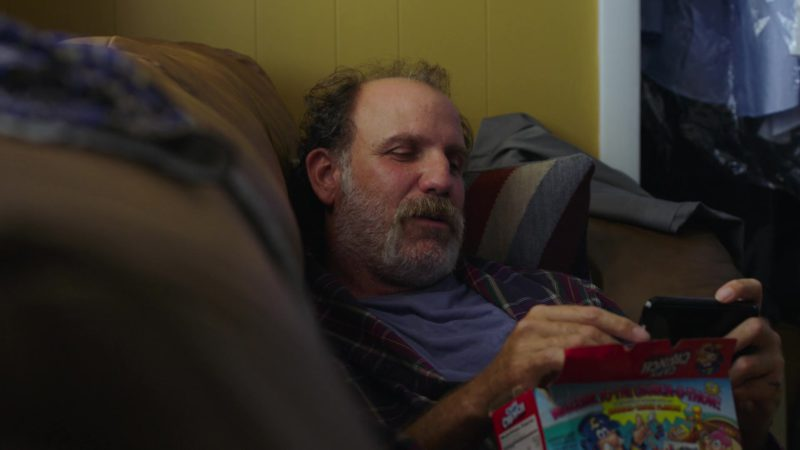 Cap'n Crunch Cereals Held by Nick Sandow (Joe Caputo) in Orange Is the New Black: Sh*tstorm Coming (2018) TV Show Product Placement