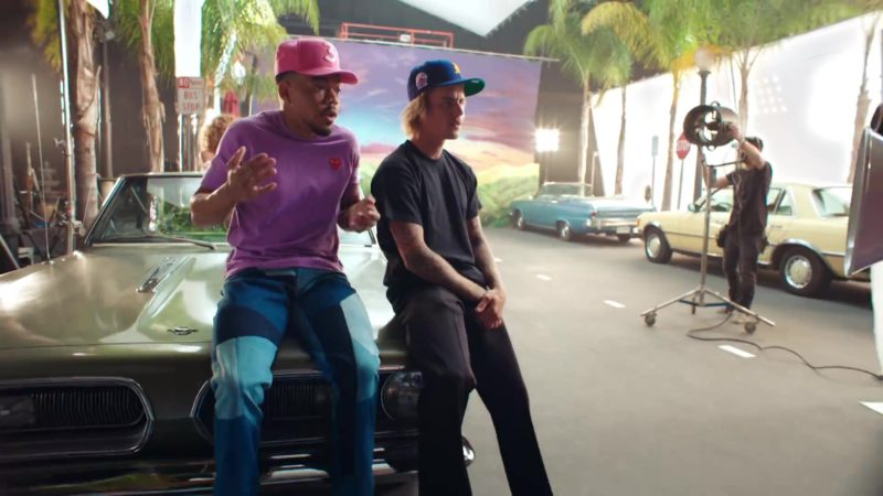 """Comme des Garçons Play Short Sleeve Logo T-Shirt and New Era Cap Worn by Chance The Rapper  in """"No Brainer"""" (2018) Official Music Video Product Placement"""