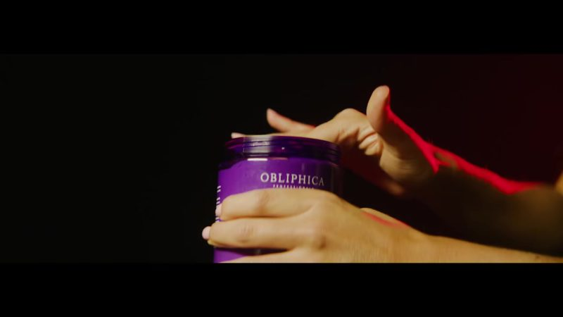 """Obliphica Professional Cosmetics in """"Brindemos"""" by Anuel AA feat. Ozuna (2018) Latin Music Video Product Placement"""
