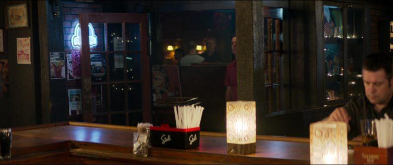 Stolichnaya Vodka Straw & Napkin Holder in Tag (2018) Movie Product Placement