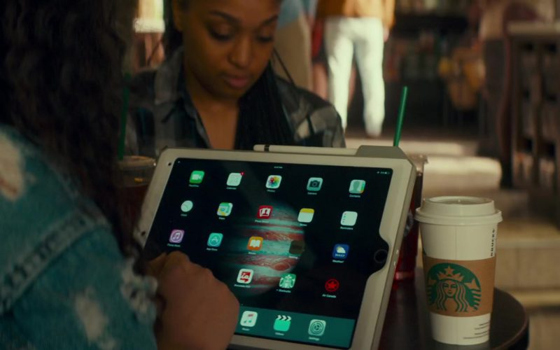Apple iPad Tablet and Starbucks Coffee in Little Italy