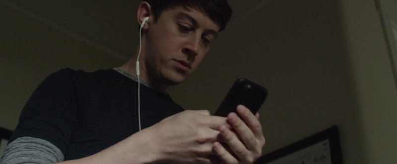 Apple iPhone with Black Leather Case Used by Alex Sharp in UFO (2018) - Movie Product Placement