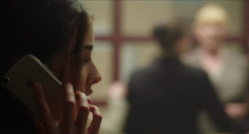 Apple iPhone Used by Olivia Culpo in Reprisal (2018) Movie Product Placement