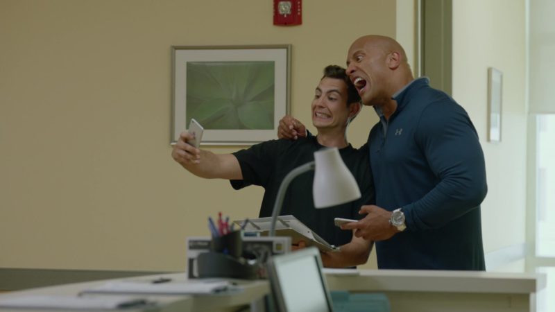"Apple iPhone and Under Armour Shirt Worn by Dwayne Johnson (Spencer Strasmore) in Ballers: Season 2, Episode 3, ""Elidee"" (2016) TV Show Product Placement"