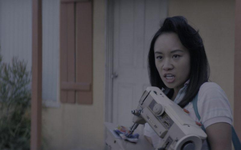 Singer Sewing Machine Held by Ellen Wong (Jenny) in Glow Season 1 Episode 10 (1)