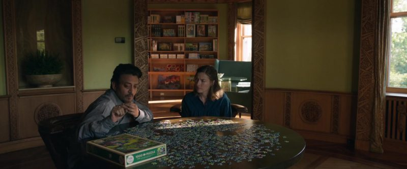 Cobble Hill Puzzles Used by Kelly Macdonald and Irfan Khan in Puzzle (2018) Movie Product Placement