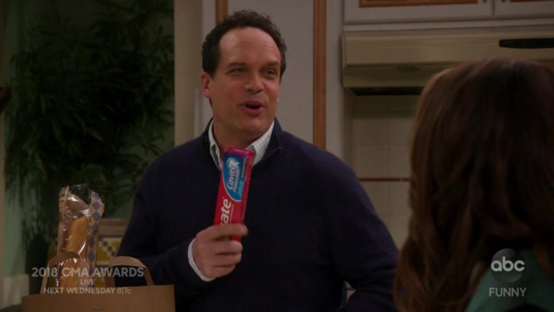Colgate Toothpaste Held by Diedrich Bader in American Housewife Season 3 Episode 7: The Code (2018) TV Show Product Placement