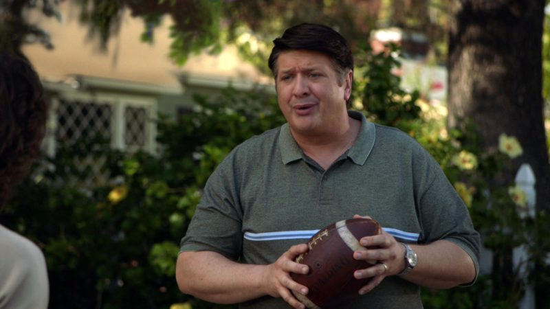 Spalding Football Held by Lance Barber in Young Sheldon Season 2 Episode 9: Family Dynamics and a Red Fiero (2018) - TV Show Product Placement